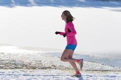 Jogger in snow Stock Photo