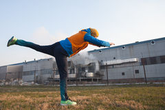 Jogger standing on one leg and stretching Royalty Free Stock Photo
