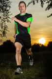 Jogger in sundown Stock Photo