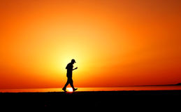 Jogger in sunset Royalty Free Stock Images