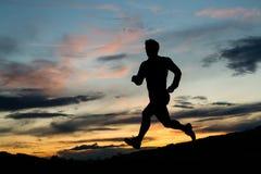 jogger sylwetki wschód słońca Fotografia Royalty Free