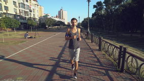 Jogger taining at day time in town. stock video