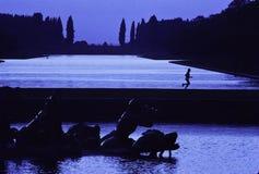 Jogger at Versailles. Jogging at the fountains at Versailles, France Royalty Free Stock Images