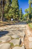 View down the ancient Via Appia Antica in Rome, Italy royalty free stock images