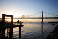 Jogger warming up near San Francisco Bay bridge Stock Photography