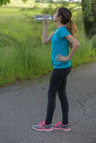 Jogger woman outdoors drinking water Royalty Free Stock Image