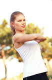 Jogger woman stretching hands Royalty Free Stock Photography