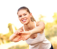 Jogger woman stretching hands Stock Photo