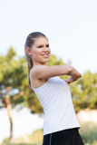 Jogger woman stretching hands Stock Images