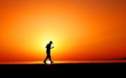 Jogger in zonsondergang royalty-vrije stock afbeeldingen