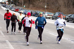 Joggers. A group of joggers enjoying the free street ahead of the Olympic torch relay in Mississauga, Ontario. Picture taken on December 19th, 2009 Royalty Free Stock Images