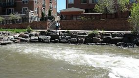 Joggers along a river stock footage