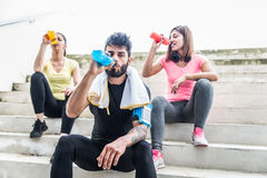 Joggers having rest and drinking Stock Photography