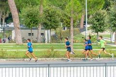 Joggers het lopen stock foto