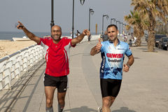 Joggers, Lebanon. Two male joggers, seafront, Lebanon Royalty Free Stock Photography