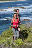 Joggers running by the caribbean sea Stock Photography