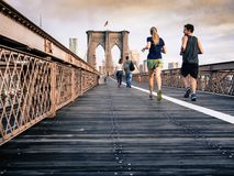 Joggers running over a bridge Stock Photography
