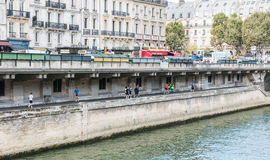 Joggers on the Seine path under the street at Place Saint Michel Royalty Free Stock Image
