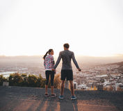 Joggers standing on hillside in morning Royalty Free Stock Images