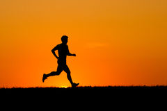 jogging ηλιοβασίλεμα Στοκ Φωτογραφία