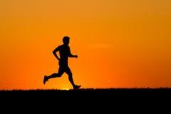 jogging заход солнца Стоковая Фотография