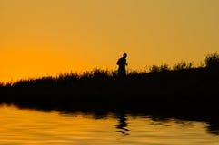 jogging заход солнца Стоковые Изображения RF