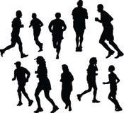 jogging силуэты стоковое изображение