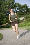 Jogging. Model Release 350 Young woman in early 20s jogging in park stock photos