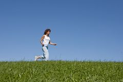 Jogging. Young woman makes sports and jogging Royalty Free Stock Photos