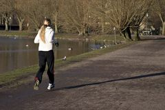 Jogging. Photo of a Girl running on park Stock Photography