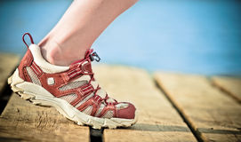 Jogging. Foot of jogging person against sea stock photography