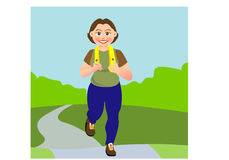 Jogging. A woman is jogging in a garden or park Royalty Free Stock Photos