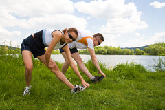 Jogging. The people stretching for jogging cross country royalty free stock photos