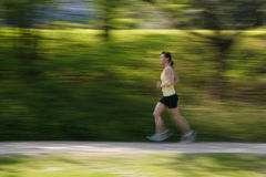Jogging. Young girl jogging along the river Royalty Free Stock Image