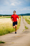 Jogging. A man jogging cross country stock photo