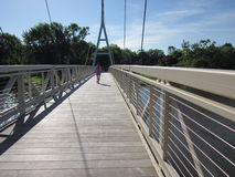 Jogging across the Charles City Iowa Suspension Br Stock Photography