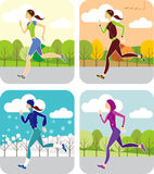 Jogging all the year round. Young woman jogging all the year round Royalty Free Stock Images
