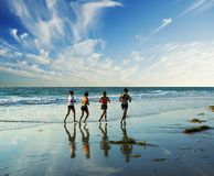 Jogging Along The Surf Royalty Free Stock Image