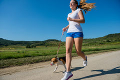 Jogging with animal friend Stock Image