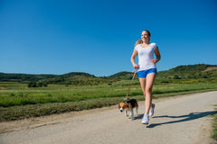 Jogging with animal friend Stock Photography
