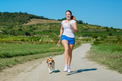 Jogging with animal friend Royalty Free Stock Image