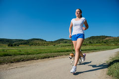Jogging with animal friend Stock Images