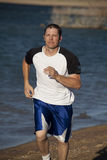 Jogging on beach Stock Photography