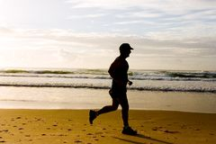 Jogging at the beach Royalty Free Stock Images
