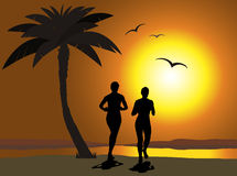 Jogging on the beach Stock Image