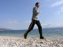 Jogging at the beach Royalty Free Stock Photos