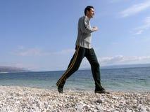 Jogging at the beach royalty free stock photos
