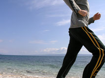 Jogging at the beach stock photography