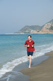 Jogging on the beach Stock Images