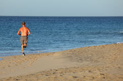 Jogging on the beach Royalty Free Stock Image